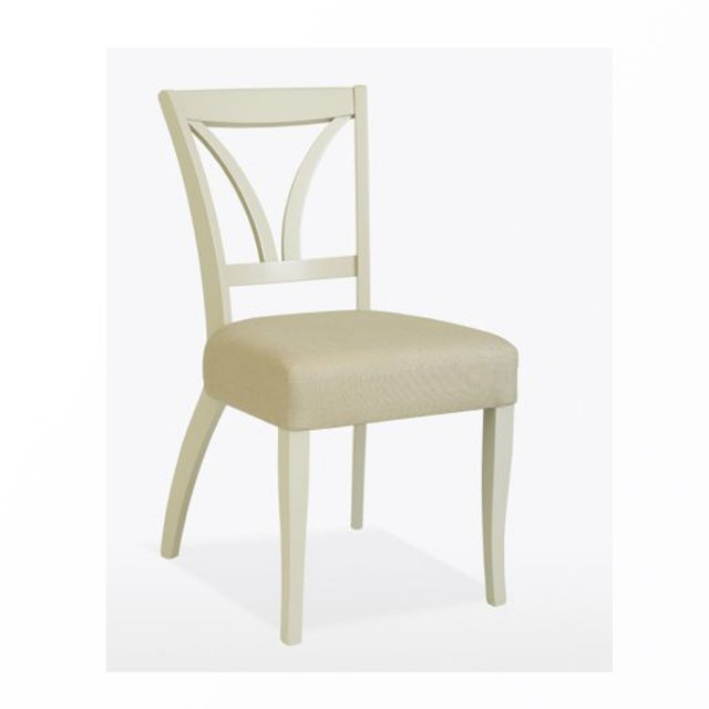 The stylish Margaret dining chair with painted legs is available upholstered in leather or fabric.
