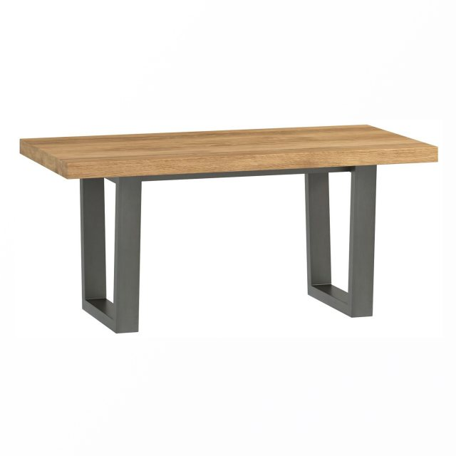 The Industrial Dining Range coffee table has a rustic oiled oak top with metal legs.
