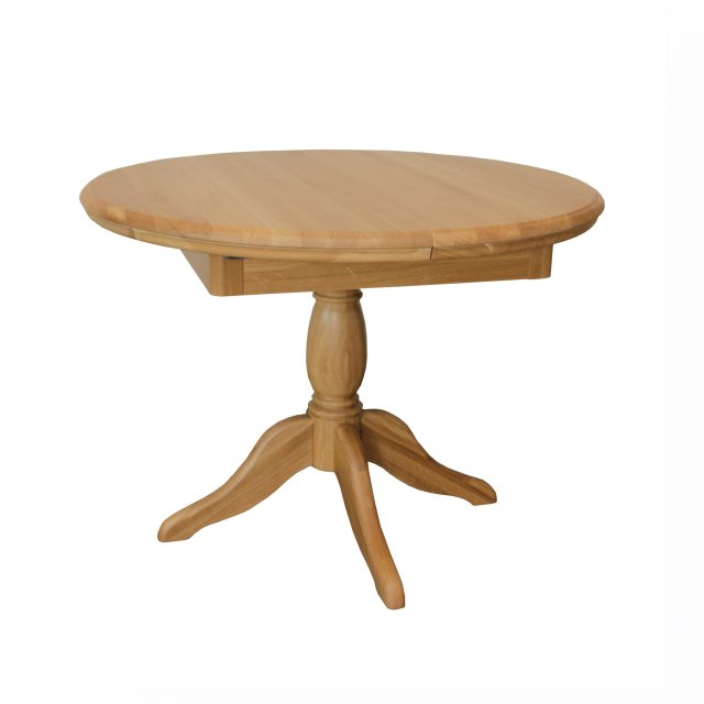 The Lamont round extending pedestal dining table is beautifully crafted from solid oak and oak venee