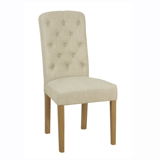 The stylish button back dining chair with painted legs is available upholstered in leather or fabric
