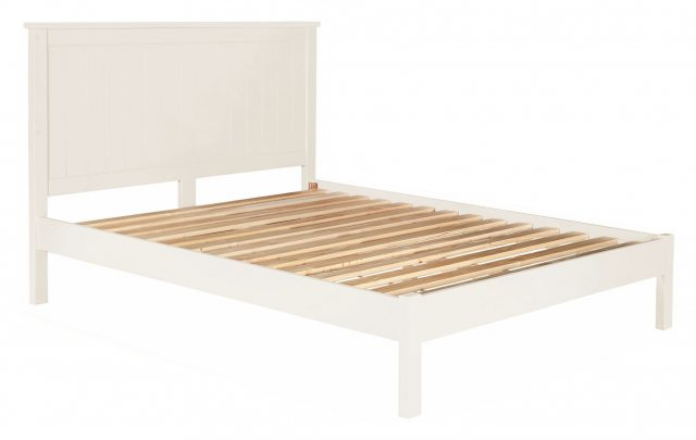 The whited painted bed had clean lined simplicity and would suit a range of decors.
