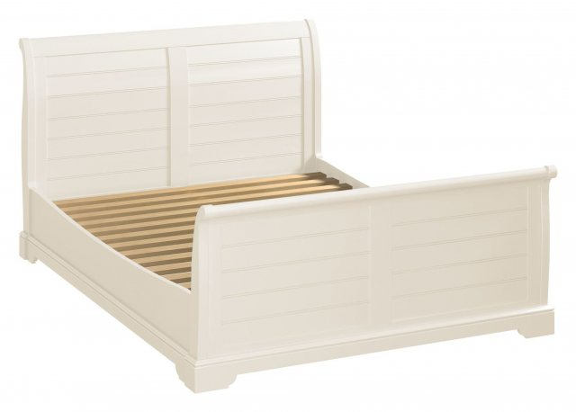 The elegant, clean lined simplicity of the white painted sleigh bed to suit a wide range of decors