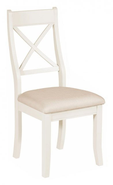 The white painted upholstered chair's elegant, clean lined simplicity suits a wide range of decors